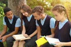 Teenage students in stylish school uniform royalty free stock photography
