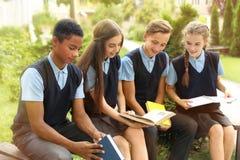 Teenage students in stylish school uniform stock photos