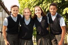 Teenage students in stylish school uniform. Outdoors stock photos
