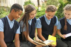 Teenage students in stylish school uniform. Outdoors royalty free stock images