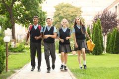 Teenage students in stylish school uniform. Outdoors royalty free stock photos