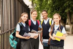 Teenage students in stylish school uniform. Outdoors royalty free stock photography