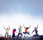 Teenage Success Team Jumping Cheerful Concept Royalty Free Stock Photos