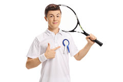 Teenage tennis player with an award ribbon pointing. Isolated on white background Royalty Free Stock Photography