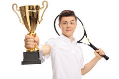Teenage tennis player holding a golden trophy. Isolated on white background Royalty Free Stock Photography