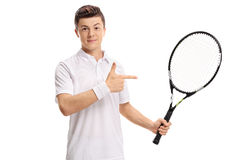 Teenage tennis player holding a racket and pointing. Isolated on white background Stock Photo