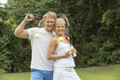 TEENAGE TENNIS PLAYERS. A portrait of two young tennis players with their racquets Royalty Free Stock Images