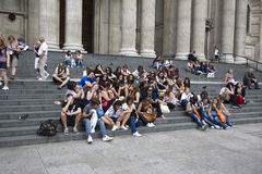 Teenage Tourists. London, UK - July 25, 2011: Teenage tourists sit on the steps of St. Paul's cathedral on July 25, 2011 in London, UK Stock Image