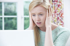 Teenage Victim Of Online Bullying With Laptop Stock Photography