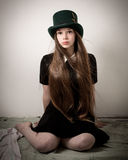 Teenage Victorian Girl With Very Long Hair And A Top Hat Stock Photo