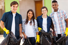 Teenage volunteers. Cheerful young teenage volunteers with garbage bag Royalty Free Stock Photo