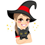 Teenage Witch Hugging Black Cat Royalty Free Stock Images