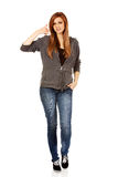 Teenage woman gesturing call me sign Royalty Free Stock Images
