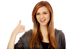 Teenage woman gesturing call me sign Royalty Free Stock Image