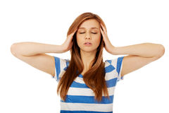 Teenage woman with headache holding her hand to the head Royalty Free Stock Images