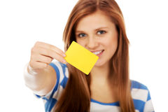 Teenage woman holding empty business card Stock Image