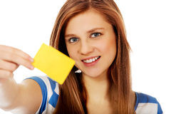 Teenage woman holding empty business card Stock Photo