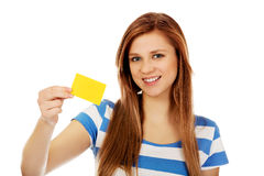 Teenage woman holding empty business card Stock Photos