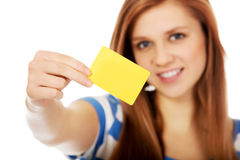 Teenage woman holding empty business card Royalty Free Stock Photo