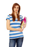 Teenage woman holding a few notebooks Stock Photo