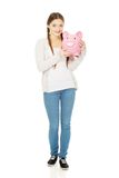 Teenage woman holding piggybank. Royalty Free Stock Photography