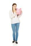 Teenage woman holding piggybank. Royalty Free Stock Photography