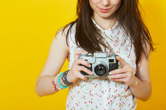 Teenage woman holding a retro film camera Stock Image