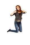 Teenage woman jumping and showing OK sing.  Royalty Free Stock Images
