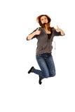 Teenage woman jumping showing thumbs up.  Royalty Free Stock Images