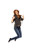 Teenage woman jumping showing thumbs up Royalty Free Stock Images