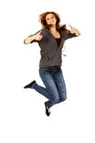 Teenage woman jumping showing thumbs up.  Royalty Free Stock Photo