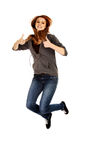 Teenage woman jumping showing thumbs up.  Royalty Free Stock Photography