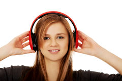 Teenage woman listening to music Stock Images