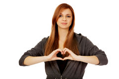 Teenage woman making heart shape with her hands Royalty Free Stock Images