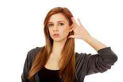 Teenage woman ovehears a conversation Royalty Free Stock Photography