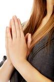 Teenage woman praying-religion concept Stock Photo