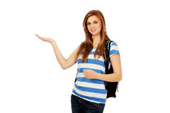 Teenage woman showing something on open palm.  stock image