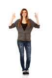 Teenage woman showing two OK signs Stock Photography