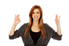 Teenage woman showing two OK signs Royalty Free Stock Photos