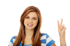 Teenage woman showing victory sign Royalty Free Stock Image