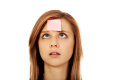 Teenage woman with sticky notes on forehead.  Royalty Free Stock Photography