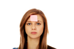 Teenage woman with sticky notes on forehead Stock Photos