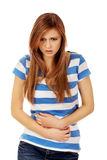Teenage woman with stomach ache Stock Photography