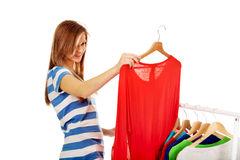 Teenage woman thinking what to dress royalty free stock photography