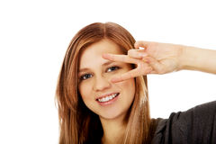 Teenage woman with victory sign on eye Stock Photography