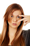 Teenage woman with victory sign on eye Royalty Free Stock Photography