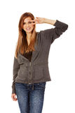 Teenage woman with victory sign on eye Stock Photo