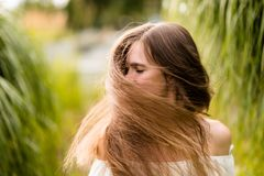 Young woman swaying her hair Royalty Free Stock Photo