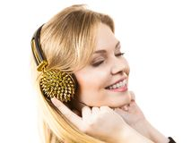 Teenage woman wearing headphones royalty free stock photo