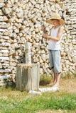 Teenage woodcutter splitting woods Stock Image